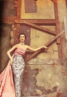 Model, Dovima; photographed by Richard Avedon for Harper's Bazaar, 1950, wearing a lovely, vintage, strapless, evening gown