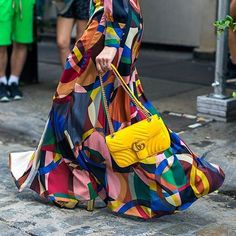 Yellow Gucci bag and colorful maxi skirt at NYFW