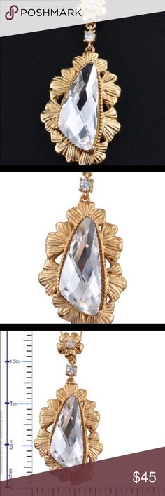 SWAROVSKI simulated diamond crystal 18k YG brass. Look classy and fashionable by adorning your neckline with this Swarovski simulated diamond crystal Pendant 18 inches long.  Set in 18k YG over platinum brass. This classic beauty radiates divine sparkles. TSW 7.050 CTS. PW 6.680 Swarovski Jewelry Necklaces