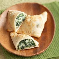Refrigerated pizza dough makes these   calzones easy to put together. Enjoy them as low-calorie snacks or appetizers.