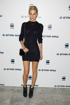 Poppy Delevigne attended the G-Star Raw NYFW event at The Highline Hotel earlier this week, and rocked a short and sexy, navy and black  striped sweater dress.