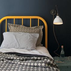 Dark grey walls + orange bed frame [linens by Egg Press + Schoolhouse Electric; lamp by Schoolhouse Electric]. Steel Bed Frame, Yellow Bedding, Yellow Headboard, Deco Kids, Schoolhouse Electric, Dark Walls, Grey Walls, Kid Spaces, My Living Room