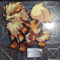 Large display piece of Arcanine in the sprite style of Pokemon Black and White Piece measures Diy Perler Bead Crafts, Diy Perler Beads, Perler Bead Art, Pokemon Perler Beads, Mario Yoshi, Pokemon Noir, Minecraft Beads, Pokemon Cross Stitch, Art Perle