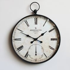 Vintage style metal large wall clock with Roman numerals and glass face.  Battery operated.