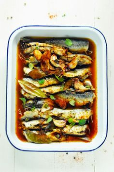 Sardines with tomatoes, olive oil, and bay leaves