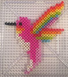Perler Beads Rainbow winged perler bead hummingbird Statistics on Children Hit by Cars In the early Perler Bead Designs, Easy Perler Bead Patterns, Melty Bead Patterns, Perler Bead Templates, Hama Beads Design, Diy Perler Beads, Perler Bead Art, Pearler Beads, Fuse Beads