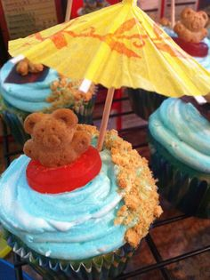 Pool Party Cupcakes...teddy graham floating in a life saver ...we did a birthday pool party....Next time! we have these. too cute