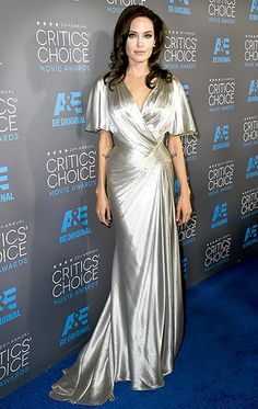 Angelina Jolie channeled Old Hollywood in an open-backed silver satin dress, draped to perfection. Bombshell curls completed the vintage-inspired ensemble.