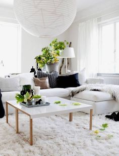 2 coffee tables together?  white living room with a nice couch, table & decoration - in adddition: cozy carpet! | Finding Fortune