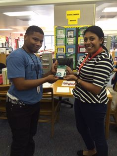 """Sam Houston MSTC Senior, Paul Allen, receiving a door prize from GRAD AmeriCorps College Access Coach, Julie Diaz, during the """"Writing a Winning Essay"""" Seminar hosted by Project GRAD."""