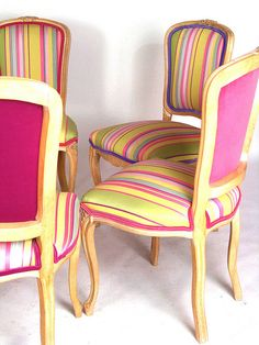 Candy-colored, striped chairs - love these but I am sure hell would have to freeze over before they would be allowed in the dining room! :)