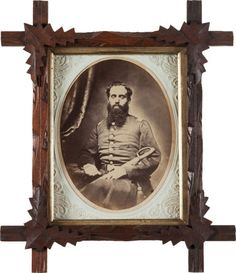 """Oval Albumen Civil War Period Portrait of Lt. Hiram Upson, 7th Connecticut Vol. Inf., Killed at James Island, S.C. 5 1/2"""" X 7 1/2"""". In original period walnut frame with unusual and original embossed paperboard mat. Period ink script ID on verso """"Capt. Hiram Upson (although he apparently only achieved the rank of Lt. prior to his death). Additional information accompanying the image, from the family, states that the ID was written by Sarah Upson, Hiram's mother. Upson is seated wearing…"""