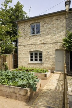 Raised beds made of oak railway sleepers Dorset Rd by Sam Tisdall Architects Sleepers In Garden, Raised Garden Beds, Raised Beds, Up House, House Front, Railway Sleepers, Into The West, Victorian Cottage, Cottage Exterior
