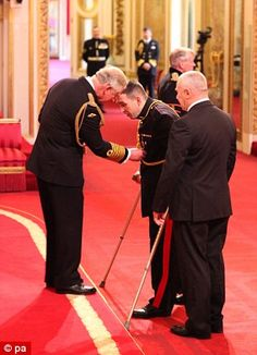 Ben Parkinson receives his MBE from Prince Charles at Buckingham Palace.