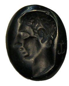 Carved oval black glass intaglio: a nobleman in profile. 100 AD