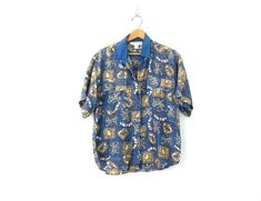 a fantastic 90s blue silk shirt. buttons up the front with 2 chest pockets. slouchy fit.  M E A S U R E M E N T S - are taken with garments laying flat, across seam to seam, and are not doubled.  ✂Please double bust, waist and hips to get the total measurement around the garment