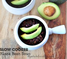 Slow Cooker Black Bean Soup, top with cilantro, avacado, tomatoe, sour cream and lime juice