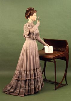 The delicate dress of chiffon, lace and velvet is an excellent example of Doucet's artistic hand. The construction of the dress is somewhat unusual, for it is a one-piece garment with a monobosom bodice and usually, a dress such as this is two-pieces. The pleated chiffon godets show the advanced technique needed to create this dress, making it a fine representation of the workmanship of the French couture.