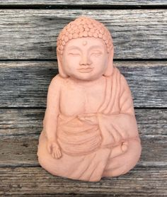 """Medium Meditating Buddha statue. Original design by Michael Gentilucci for Designer Stone. H6"""" x W5"""" D4"""" 4lbs. Handcrafted solid cast stone. Made in the USA. Available in 4 colors. Shown in Sedona."""