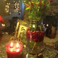 Pretty homemade Christmas centerpiece with berries and mason jar