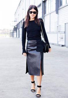 Pair a leather side-slit skirt with black sweater, strap heels and a black shoulder bag