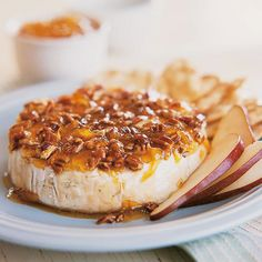 Our praline-topped baked brie can be ready in just 20 minutes-perfect for a last-minute get together. More make-ahead #holiday sides: http://www.bhg.com/christmas/recipes/25-minute-or-less-holiday-appetizers/?socsrc=bhgpin111512parlinebrie#page=17