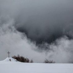 Surrounded. #snowday #clouds #mist #cross #snow #france #leslaix #trees #mountain #moody  #view #valley #canon
