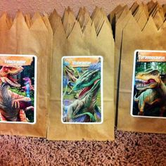 Dinosaur favor bags: I used regular lunch bags (cut them jagged) and glued on dinosaur flash cards. Got the cards at Target, they were $1.00 for 36 different ones. Plan to have each party guest hunt for a different dinosaur. ~Julie
