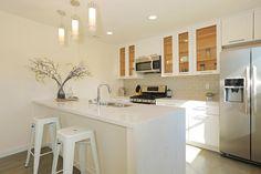 Crisp kitchen from @numihome. Beautiful #quartz countertop with HL #backsplash. Create yours