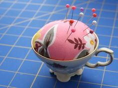 Teacup pin cushion --When I made mine, I used a tonal for the fabric, put lace around the edges, and glued the whole thing to its saucer so I had a spot for my seam ripper, little scissors, etc. I also put steel wool inside the layer of batting. Polyfil will dull pins, but steel wool sharpens them everytime you stab them in!