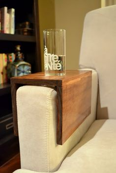 DIY wooden couch sleeve from The Ugly Duckling House allows you eliminate an end table but still keep a beverage nearby.