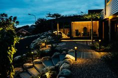 From a project we did in This garden is lighted in various ways with groundspots/pullerts/strips/wall armateures. Design and build by Komplett Utemiljø :) Stripped Wall, Garden Pool, Mansions, Lighting, House Styles, Building, Design, Home Decor, Decoration Home