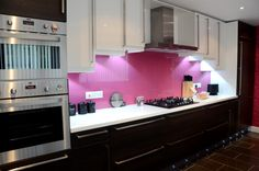 Just finished installing this kitchen, cuban oak, white high gloss and pink glass spashback.