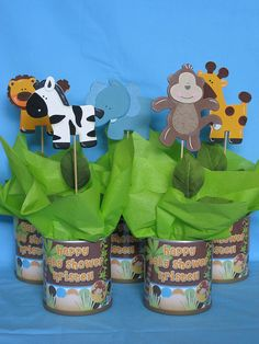 baby shower centerpieces | safari baby shower centerpieces.  This could be done with any theme and very inexpensively. Tin cans.