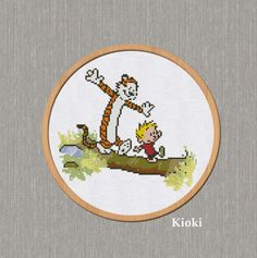 Cross-stitch-pattern-Calvin-and-Hobbes-on-log-Counted-Chart-Scheme-DMC-PDF