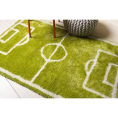 A spicy mix of trendy and hip designs, this area rug features a graphic pattern in green that is perfect for fun loving teenagers and the young at heart. Its durable construction is perfect for everyday use.