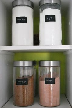 Pretty storage containers makes it easier to utilize open cabinets spaces and shelves for a larger looking kitchen.