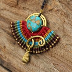 woven cotton tribal pendant with hand shaped brass and