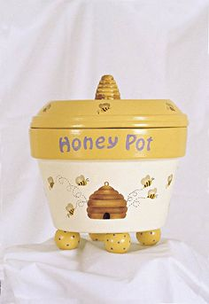 Be on the look out or Winnie the Pooh with this honey pot decorated terracotta pot. There is a baby's room waiting for this!