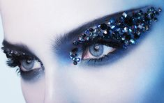 """Intense blue eye make-up """"mask"""" with tons of crystal embellishments."""