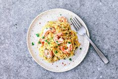 Lighten things up by bringing spicy and garlicky shrimp scampi to tender spaghetti squash. Spaghetti Squash Shrimp Scampi, Cooking Spaghetti Squash, Clean Eating Meal Plan, Clean Eating Recipes, Garlicky Shrimp, Onion Vegetable, Snack Recipes, Healthy Recipes, Healthy Meals