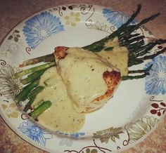 Cajun grilled chicken with homemade Alfredo sauce and roasted asparagus. I can't believe how good this is. #keto #lowcarb #yummy #healthyliving #healthyfood #fitmom #fitnesslifestyle by nikkif09