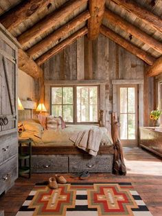 Log cabin bedroom - Look at that rug!  The drawers under the bed look great too :)