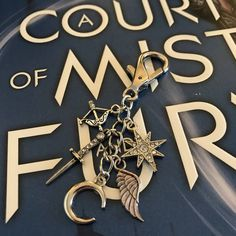Night Court Keychain, A Court of Mist and Fury, Rhysand and Feyre, Bookworm Keychain, Metal Stamped Keychain, Bookish Keychain, Book couple by BookishAdventures on Etsy https://www.etsy.com/listing/570558590/night-court-keychain-a-court-of-mist-and