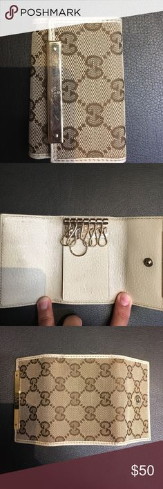 Gucci Key holder authentic Authentic, Gucci key holder. Hardly used. Still in good condition, the metal has scratches see pic. Gucci Accessories Key & Card Holders