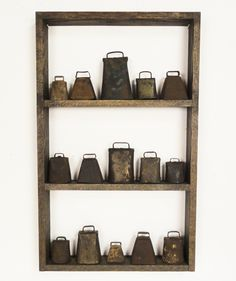 "www.lostfoundart.  A collection of 15 antique cow bells in custom made dark stained oak shadow box. display measures 17 1/2"" wide x 28 1/2"" tall and 2 1/2"" deep."