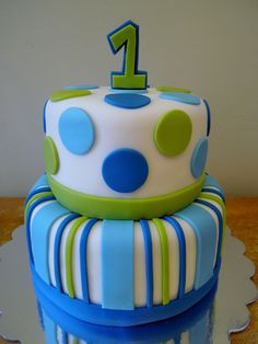 Use fondant dots and strips for a chic & simple first birthday cake