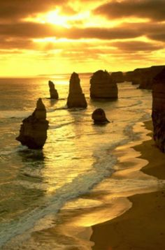 "Photo: Victoria Coast Sunset: ""The stone spires off Victoria's coast are called the Twelve Apostles ."" —From ""Closing the Circle: Australia by Bike, Part Three,"" April National Geographic magazine Photograph by R. Amazing Sunsets, Beautiful Sunset, Beautiful World, Beautiful Places, Peaceful Places, Beautiful Scenery, Sunset Landscape, Landscape Pictures, Strand"