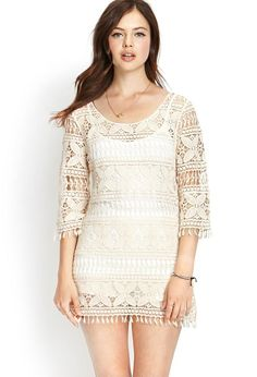This shift dress features a detailed crochet knit pattern and fringed trim. . 3/4 sleeves. Unlined. ...