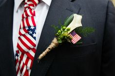 Patriotic Boutonniere- White Calla Lily, Spring Green Hypericum Berries and an American Flag wrapped in Rustic Twine- Kiwi Fleur #wedding #savannahwedding #southernwedding